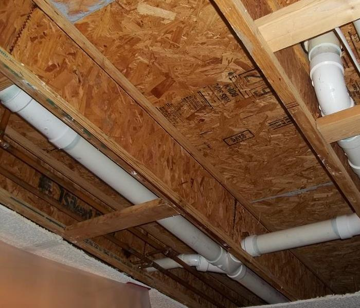 Ceiling removed, wood exposed after water remediation