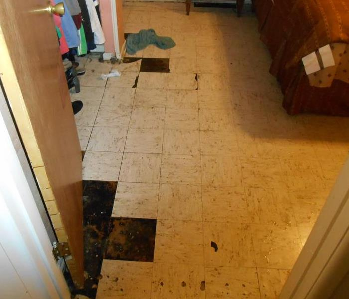 Tile floor separating from the concrete underneath due to water