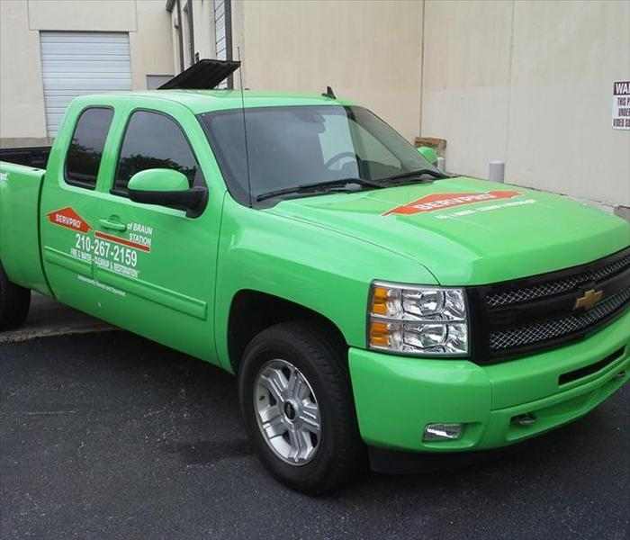 Green truck with SERVPRO logo