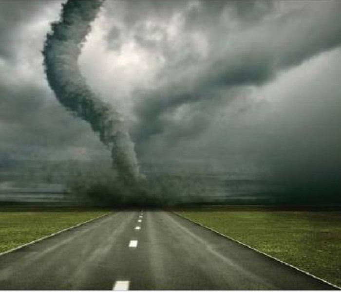 Tornado touching down in the middle of a roadway