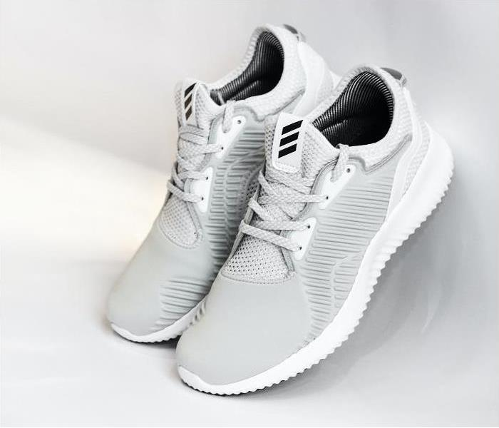 Pair of grey running shoes on white background