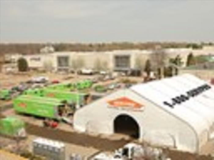 SERVPRO tent and several green vehicles outside of the large tent