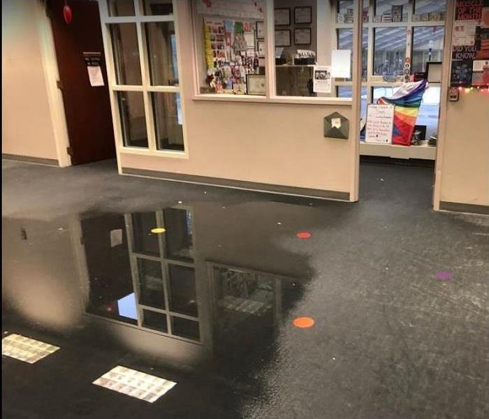 Standing water on floor of commercial property