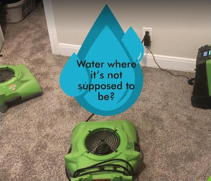 SERVPRO restoration equipment with water drop saying