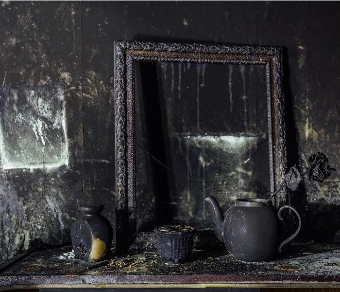 Fire damaged mirror and personal items