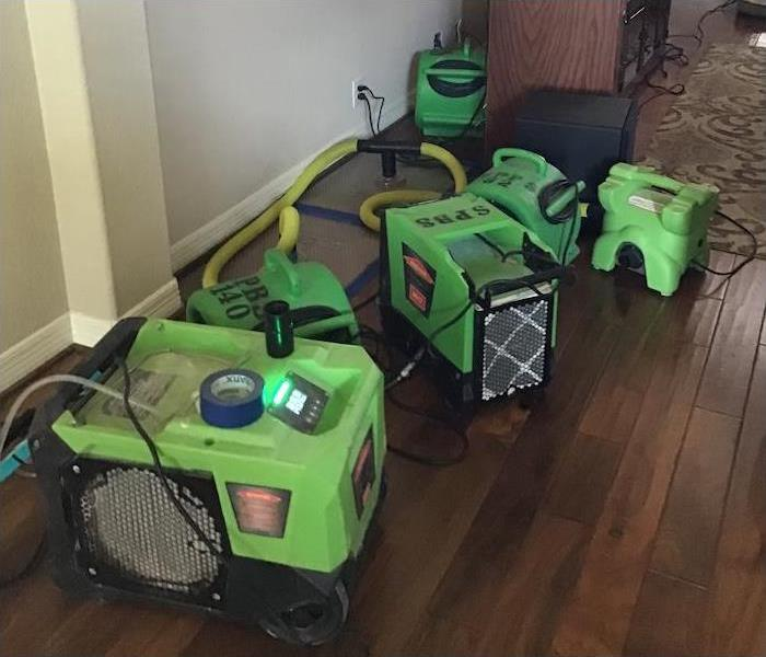 Dehumidifiers, Air Movers, Drying Mat positioned on a Hardwood Floor in Leon Valley, Texas