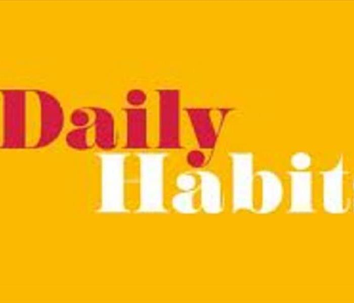 The words Daily in red and Habit in white with a yellow background